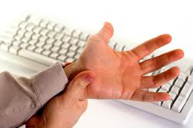 Carpel Tunnel Syndrome pain relief using keyboard offered by Chiropractors of San Diego Chiropractic Massage
